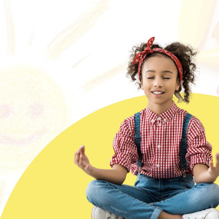 a kid meditating with a smile