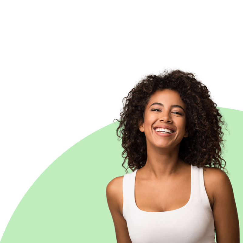 black woman smiling on green background